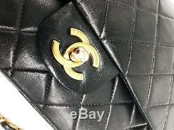 Sac à main Chanel Timeless / Classique en cuir noir médium double flap
