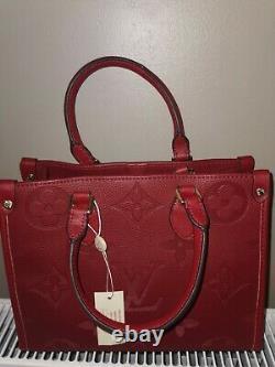 Sac à main Louis Vuitton Onthego rouge