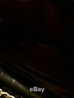 Sac chanel avec bandoulière chaînette et les deux c entrelacés dans le cuir